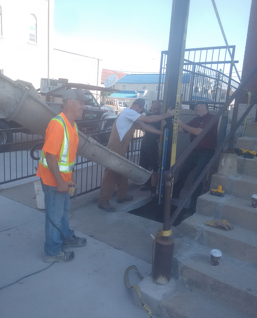 pouring concrete for new sign post