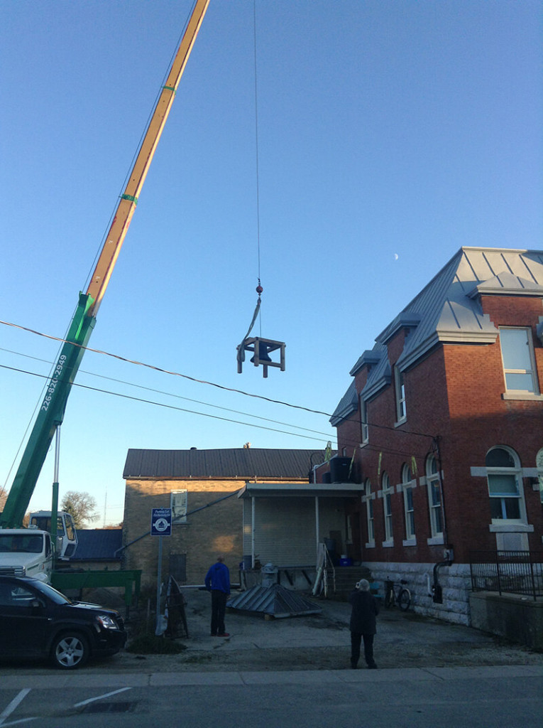 bell hoisted onto roof of harriston old post office