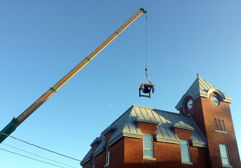 bell hoisted to roof of harriston old post office