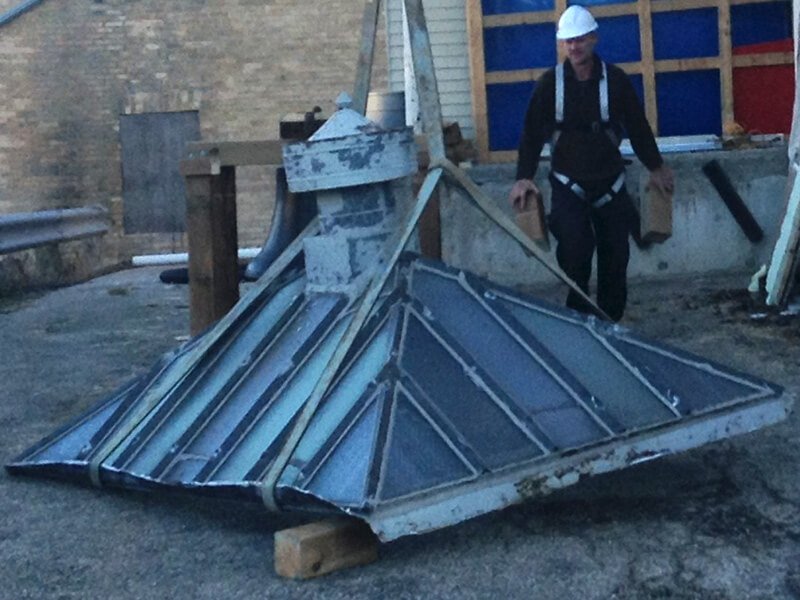 contractor reviews skylight at harriston old post