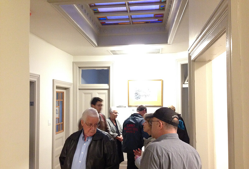 people tour second floor of harriston old post office